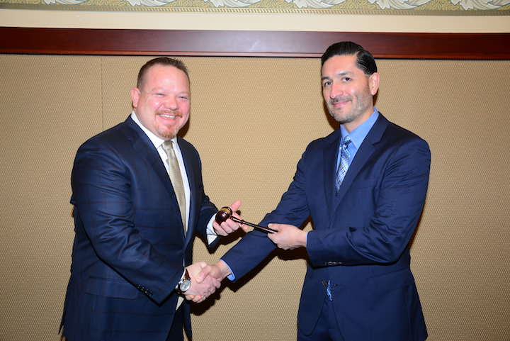 2019 Chairman Andrew Bivens of Westlake Produce Company accepts the gavel from 2018 chair Alfonso Cano of Lucky