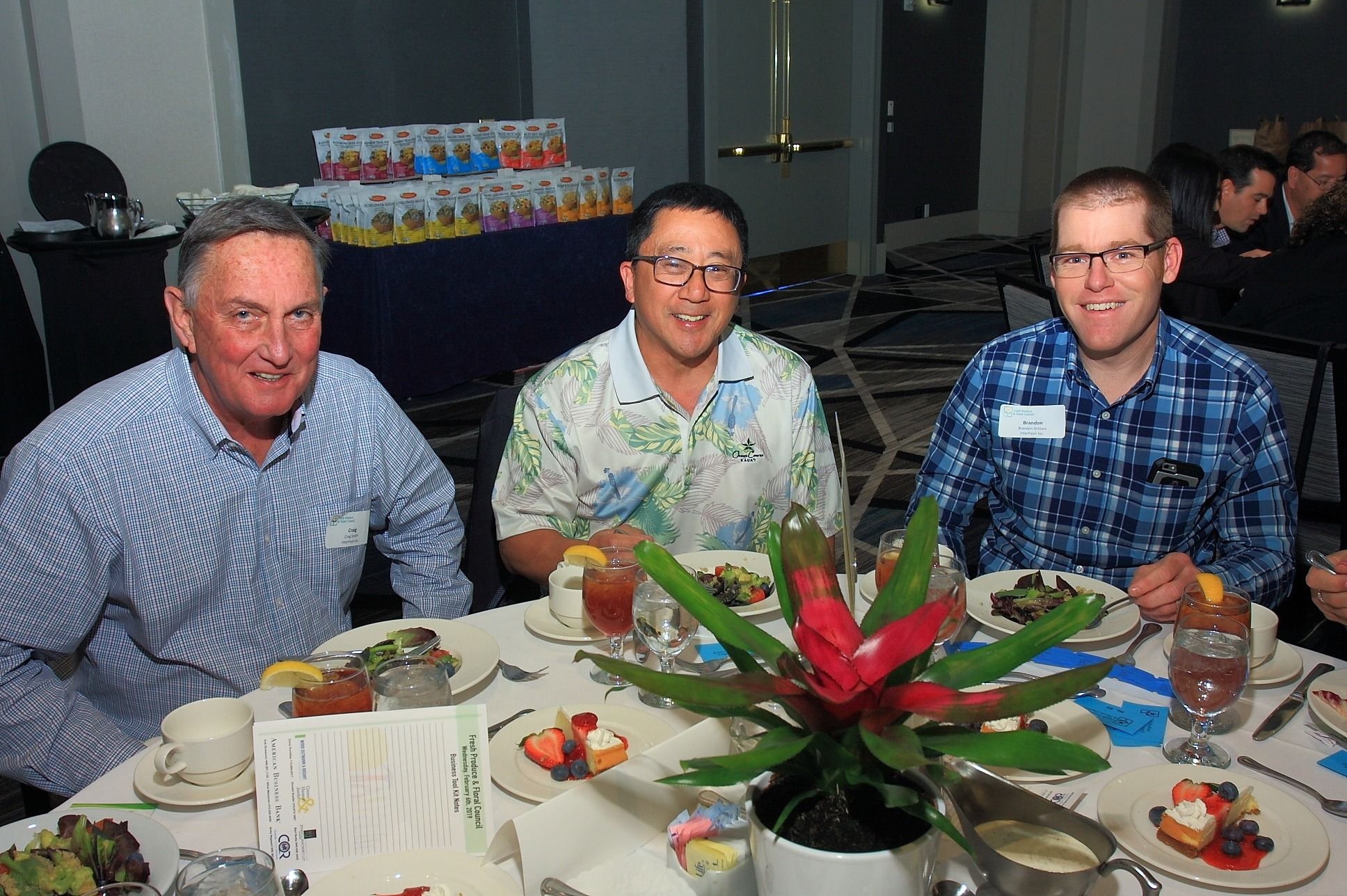 Randy Akahoshi of 4Earth Farms (center) with Craig Smith and Brandon Gritters of InterFresh