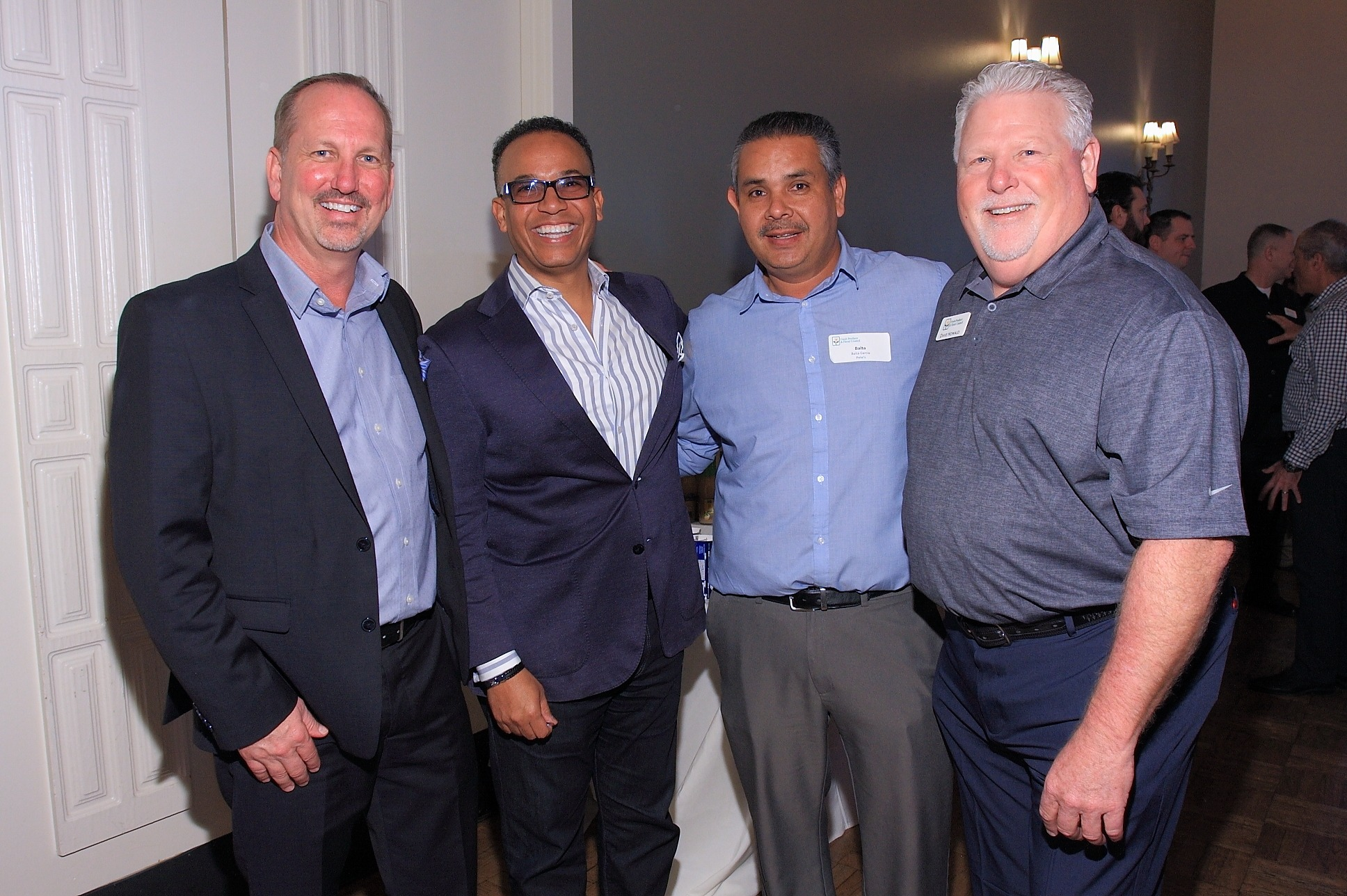 Greg Corrigan of Raley's Supermarkets with Robert Thompson of FreshSource, LLC, Baltazar Garcia of Pete's and Dave Howald of Pear Bureau Northwest