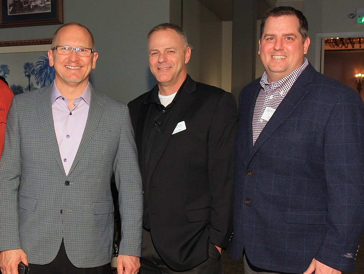 Scot Olson of FreshSource, LLC with Daniel Bell and Doug Montgomery of Grocery Outlet