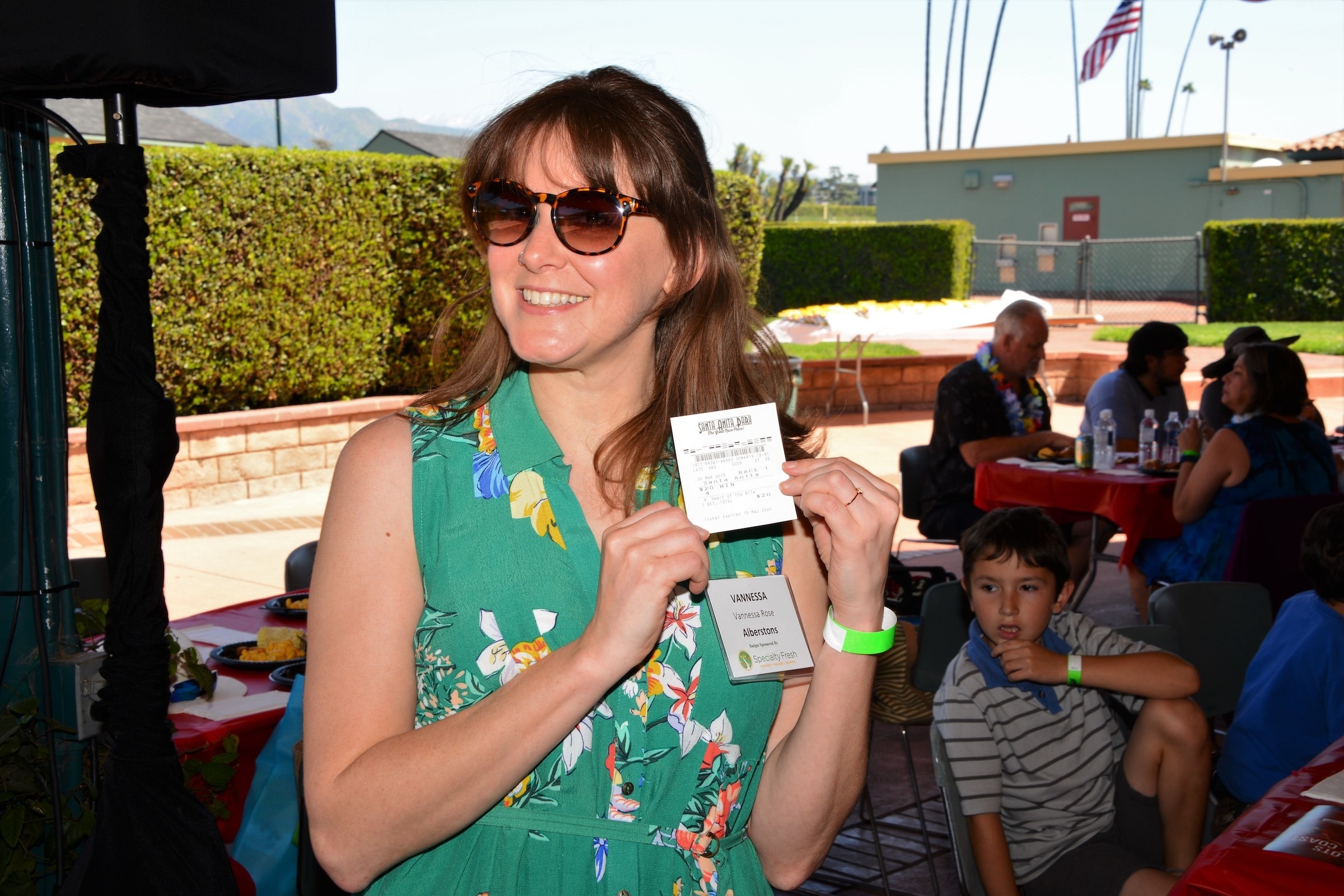 Vanessa Rose from Albertsons won a pick in the first race in the door prize raffle