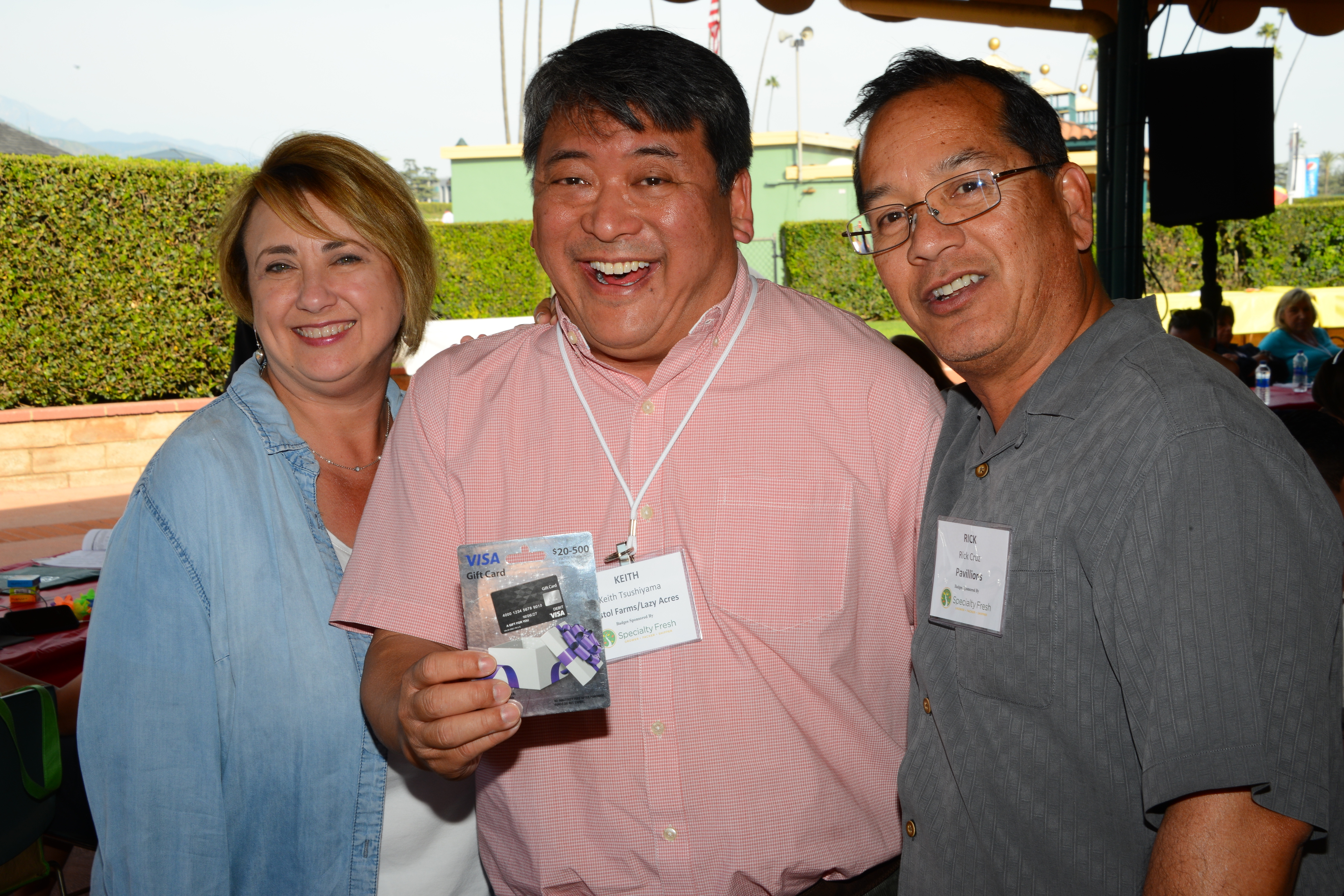 FPFC President Carissa Mace and Races Committee Chairman Rick Cruz of Pavilions with $500 winner Keith Tsushiyama of Bristol Farms