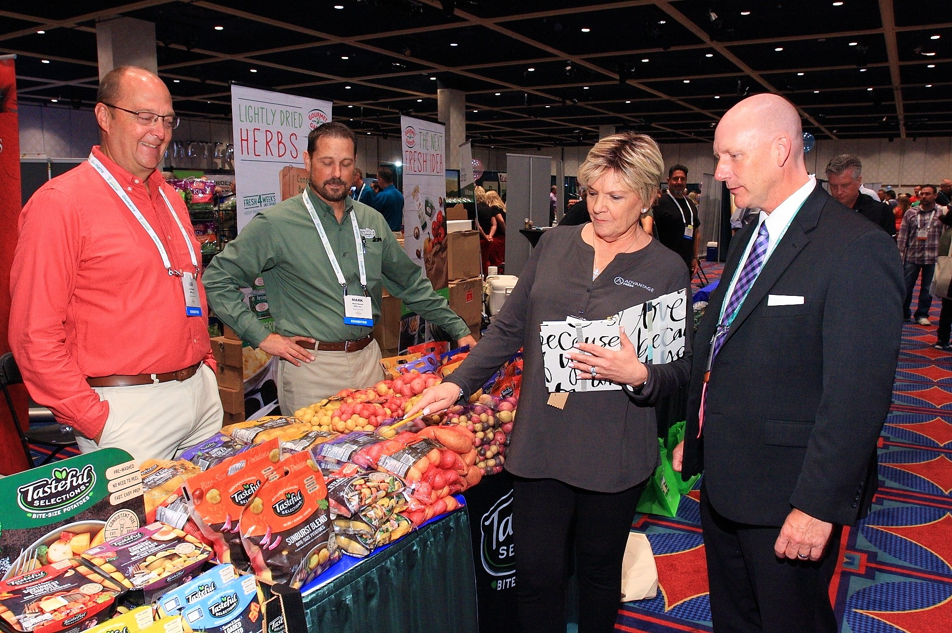 Lee Brown and Mark Bucek from RPE, Inc., and Nancy Hamilton from Advantage Fresh discuss new products with Don Gann from Stater Bros. Markets