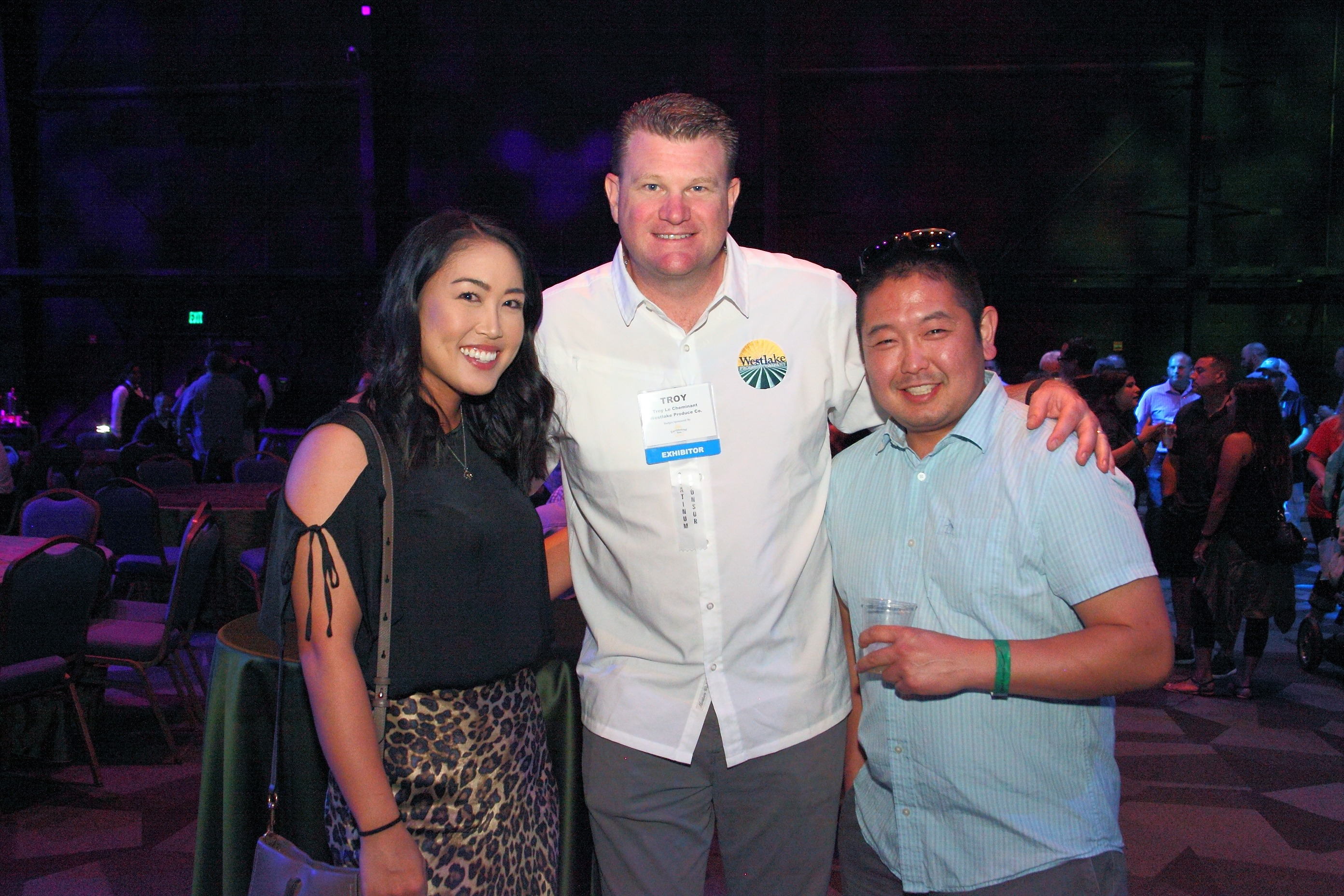Troy LeCheminant from Westlake Produce Company (center) with Megan Ichimoto and Garrett Nishimori from San Miguel Produce