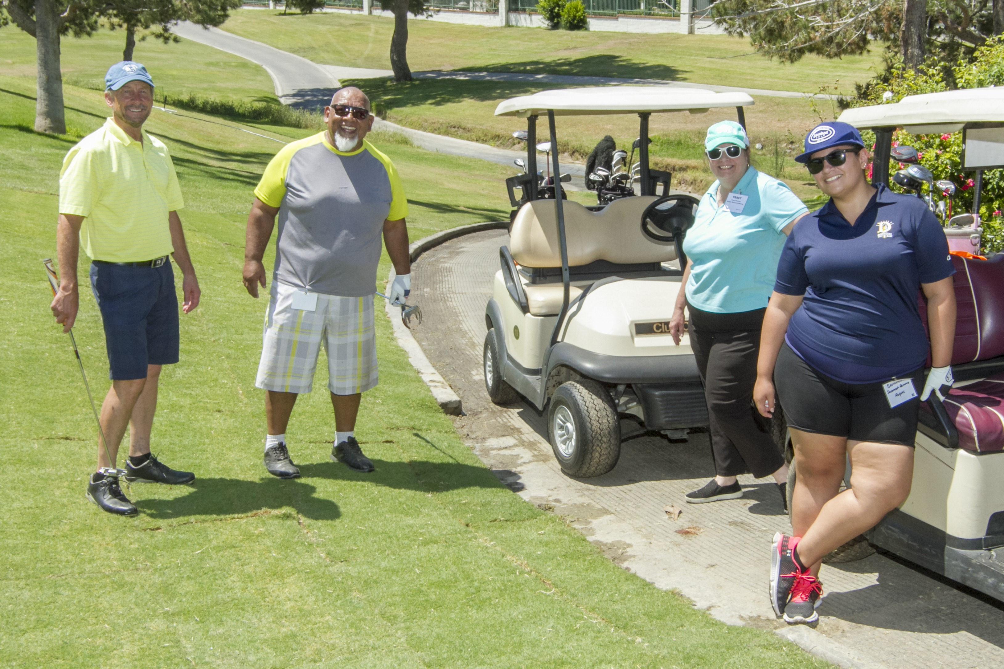 Phil Guardia with The Pinery, LLC, on the course with Jesse, Tracy, and Savannah Ramirez of Ralphs Grocery Company.