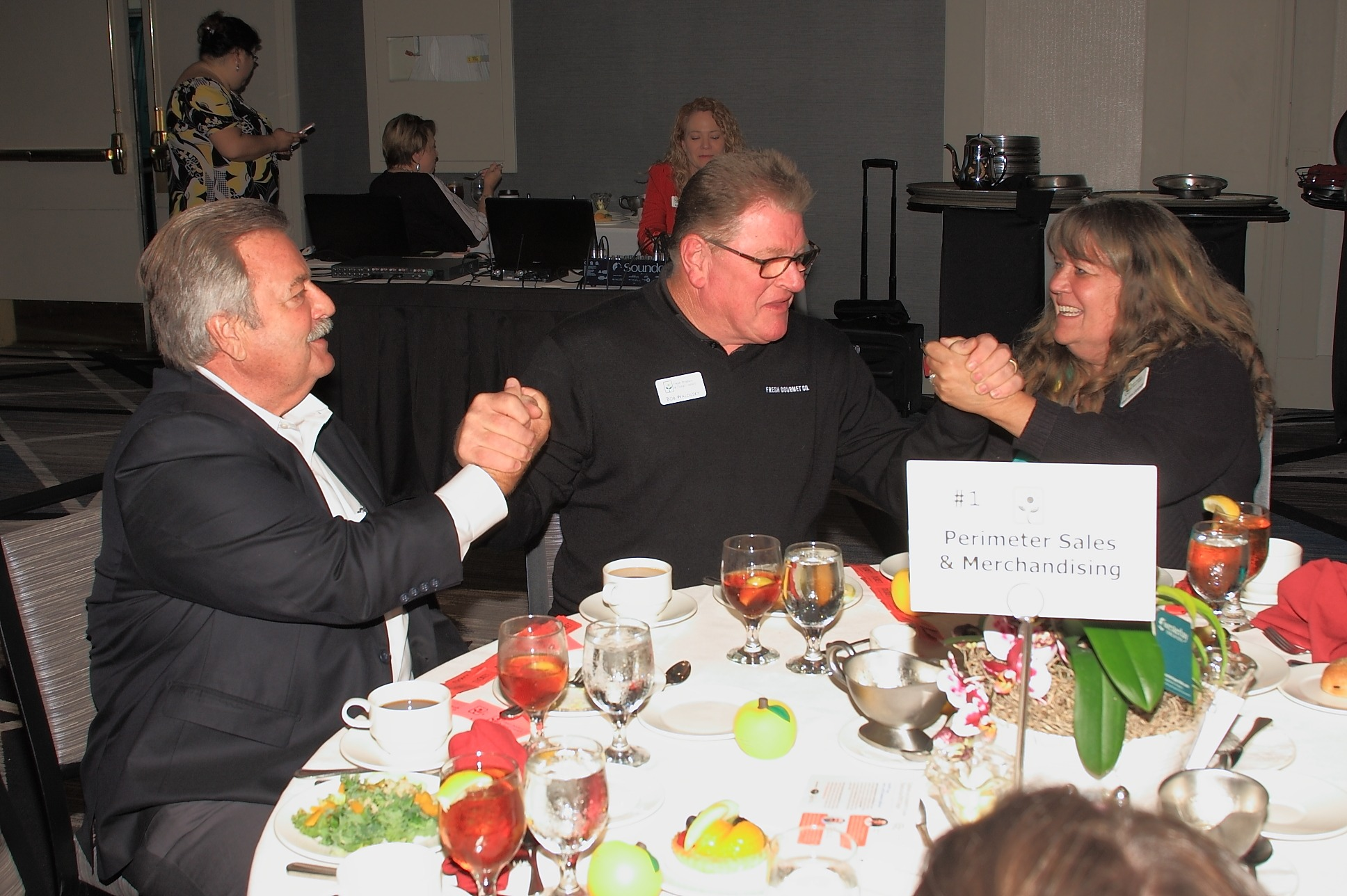 Bob Waldusky of Fresh Gourmet Company negoatiates with Brad Martin and Mary Ann Gunther of Perimeter Sales and Merchandising