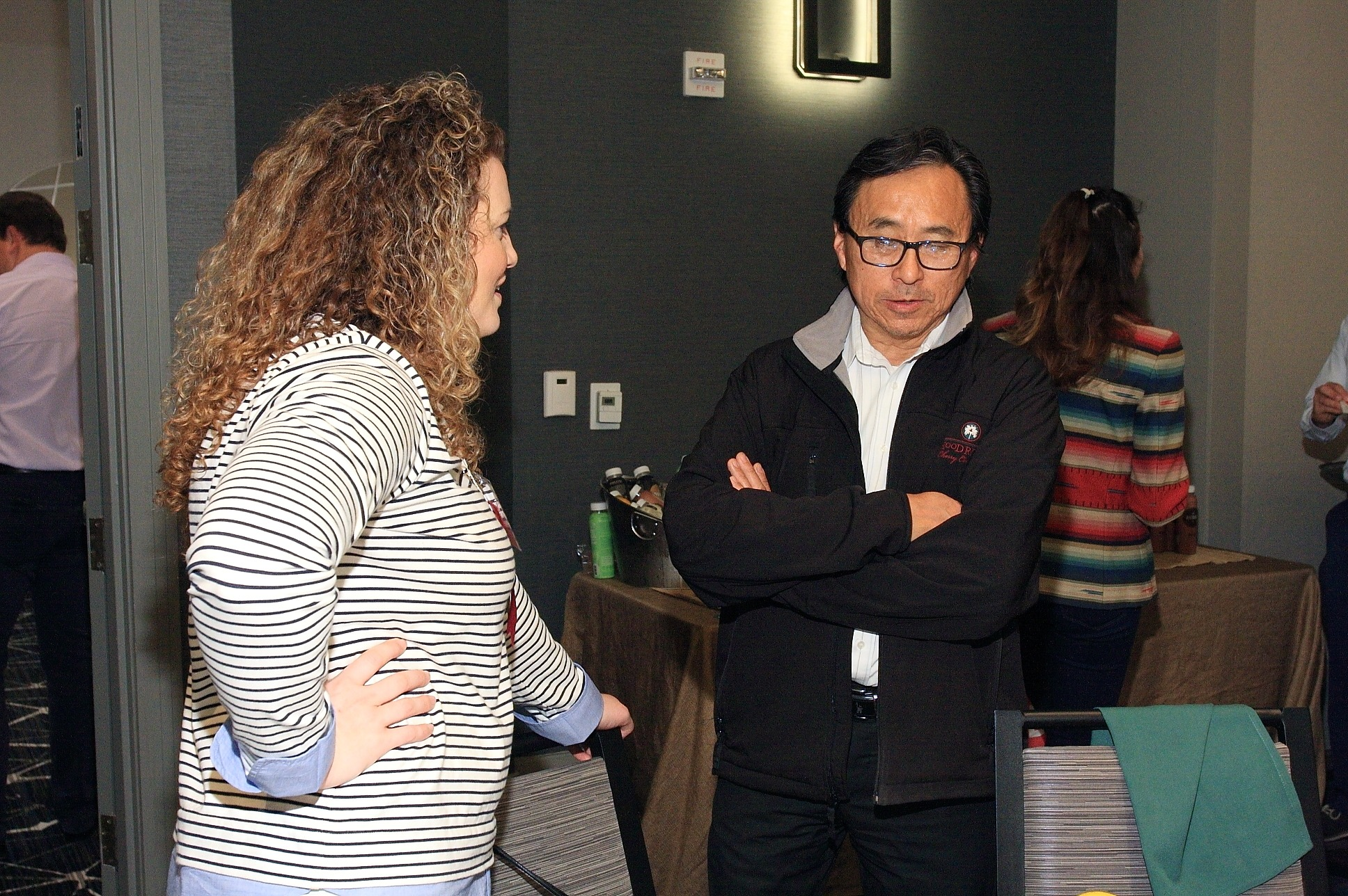 Kori Martin of The Oppenheimer Group and John Fujii from Gelson's Markets chat before the luncheon
