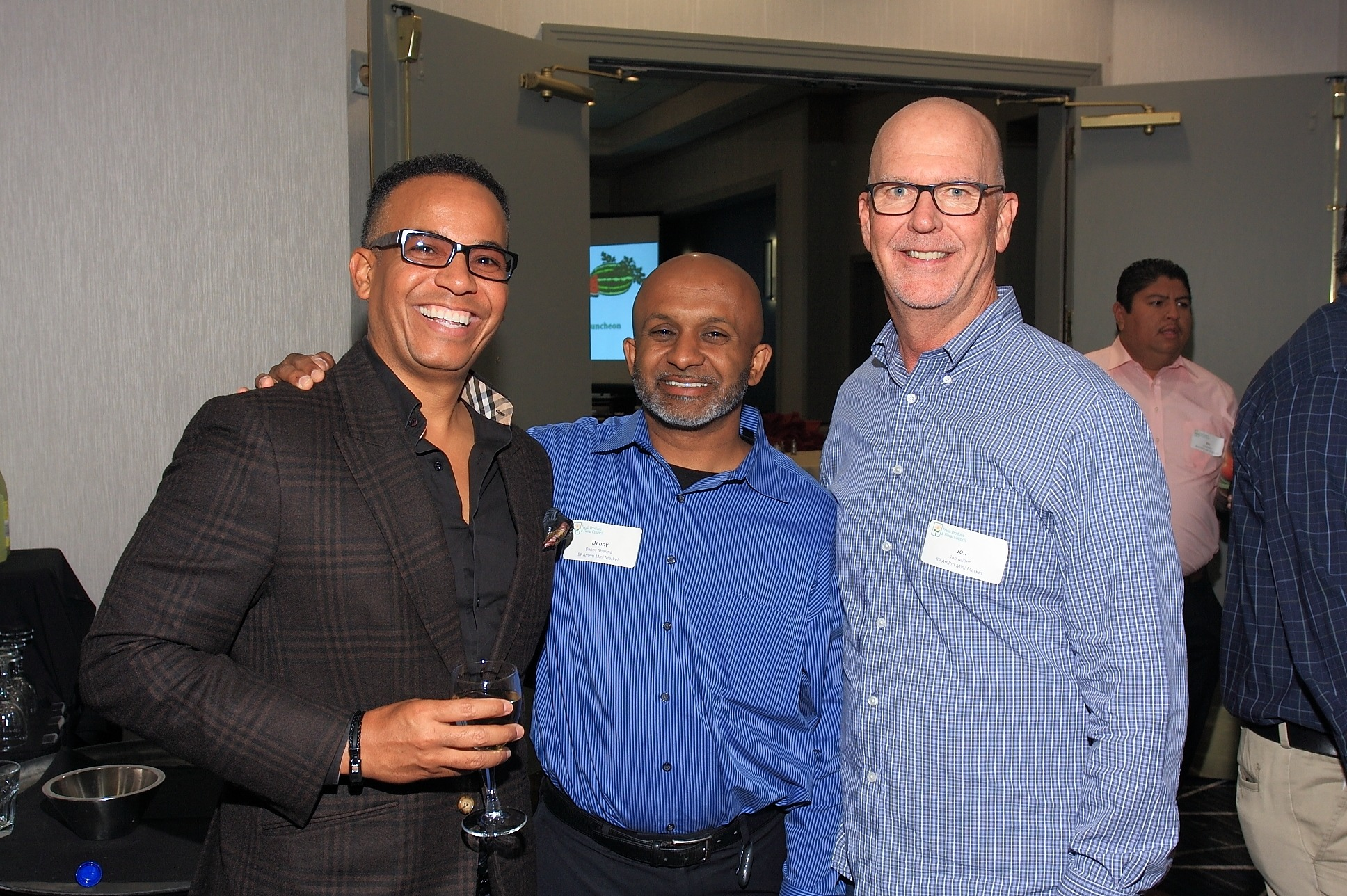 Robert Thompson of FreshSource with Denny Sharma and John Miller of ampm Mini Market.