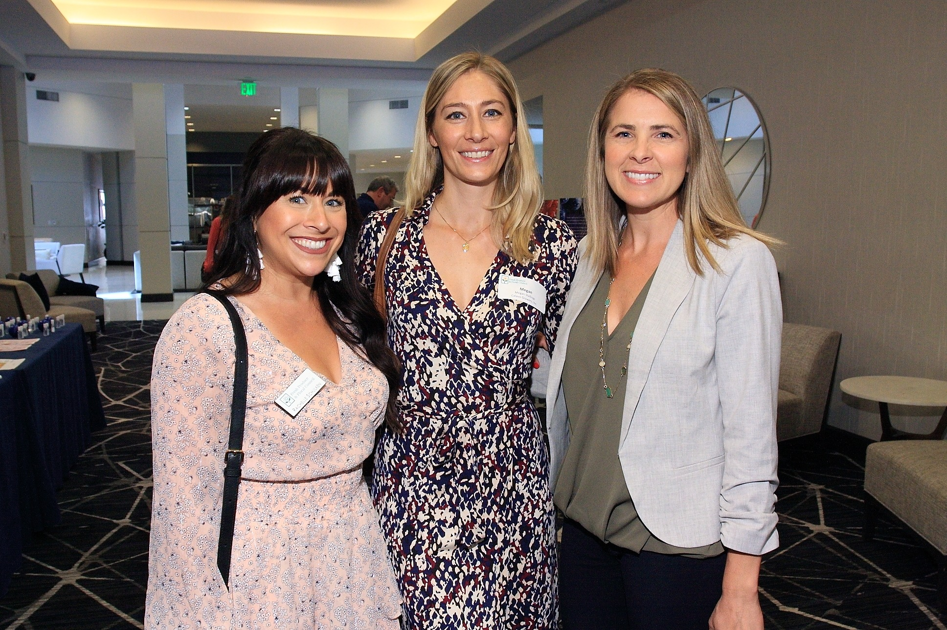 Rachelle Schulken of Renaissance Food Group, LLC., Megan Stallings of Calavo Growers Inc., and Audrey Dunne of Curation Foods, catching up at the post-luncheon networking hour.