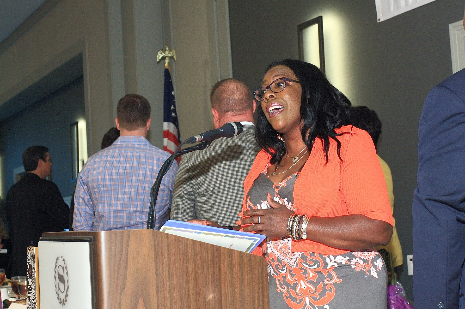Angela Fraser with California Avocado Commission sings the National Anthem.