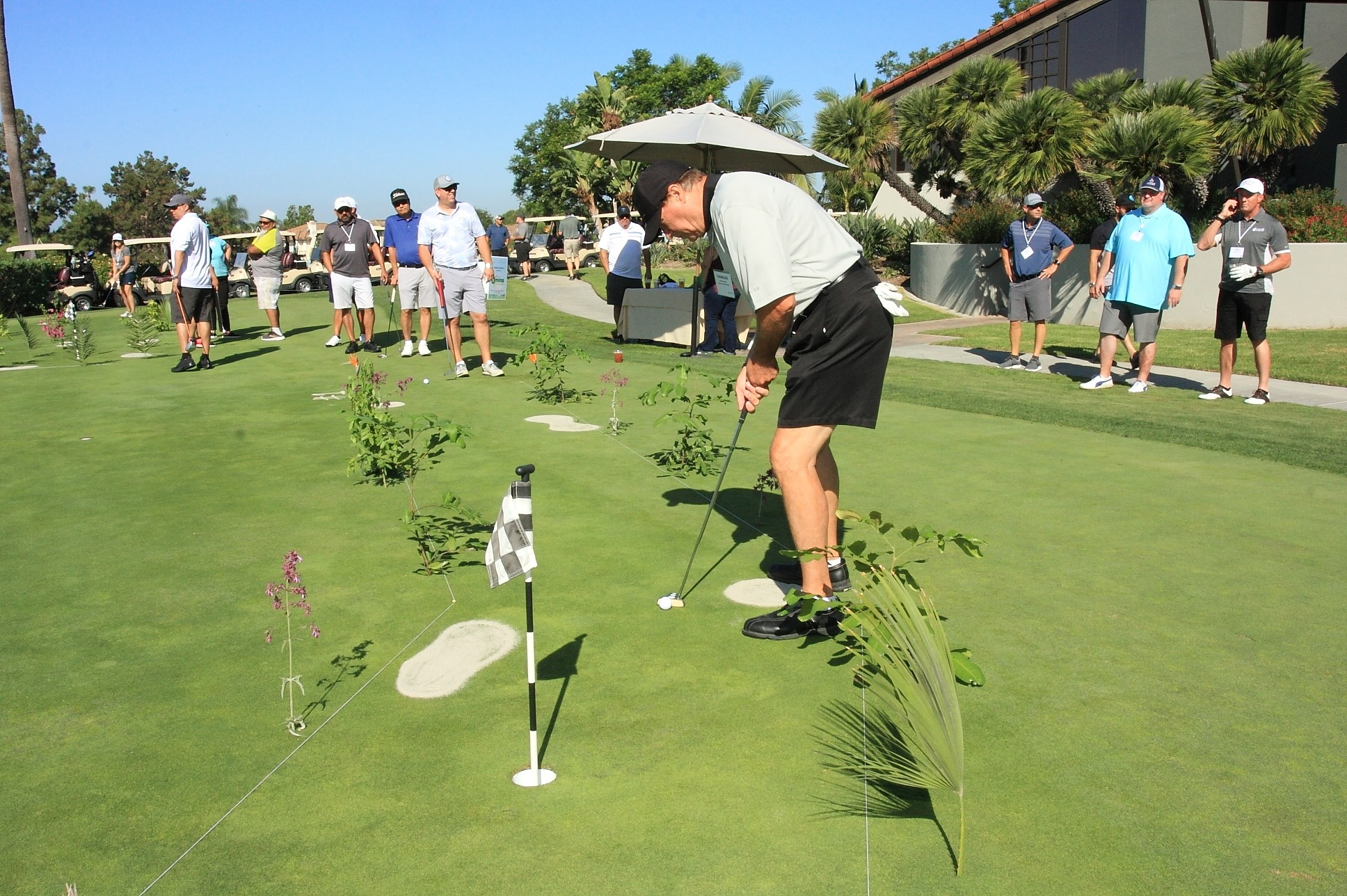 Charles Alter with Sunview Marketing, competing in the pre-tournament putting contest.