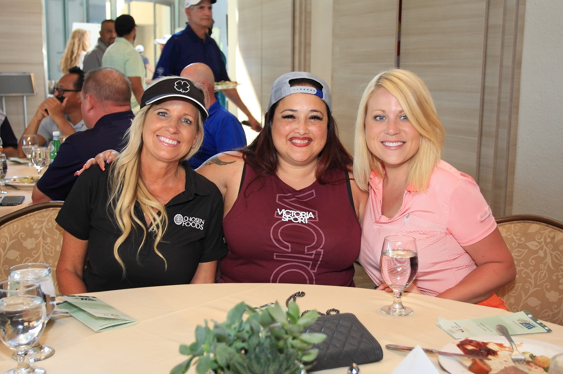 Kristyn Lawson with Chosen Foods, Patricia Jimenez of Fresh Concepts, and Caitlin Tierney of 99 Cents Only Stores at the awards dinner.