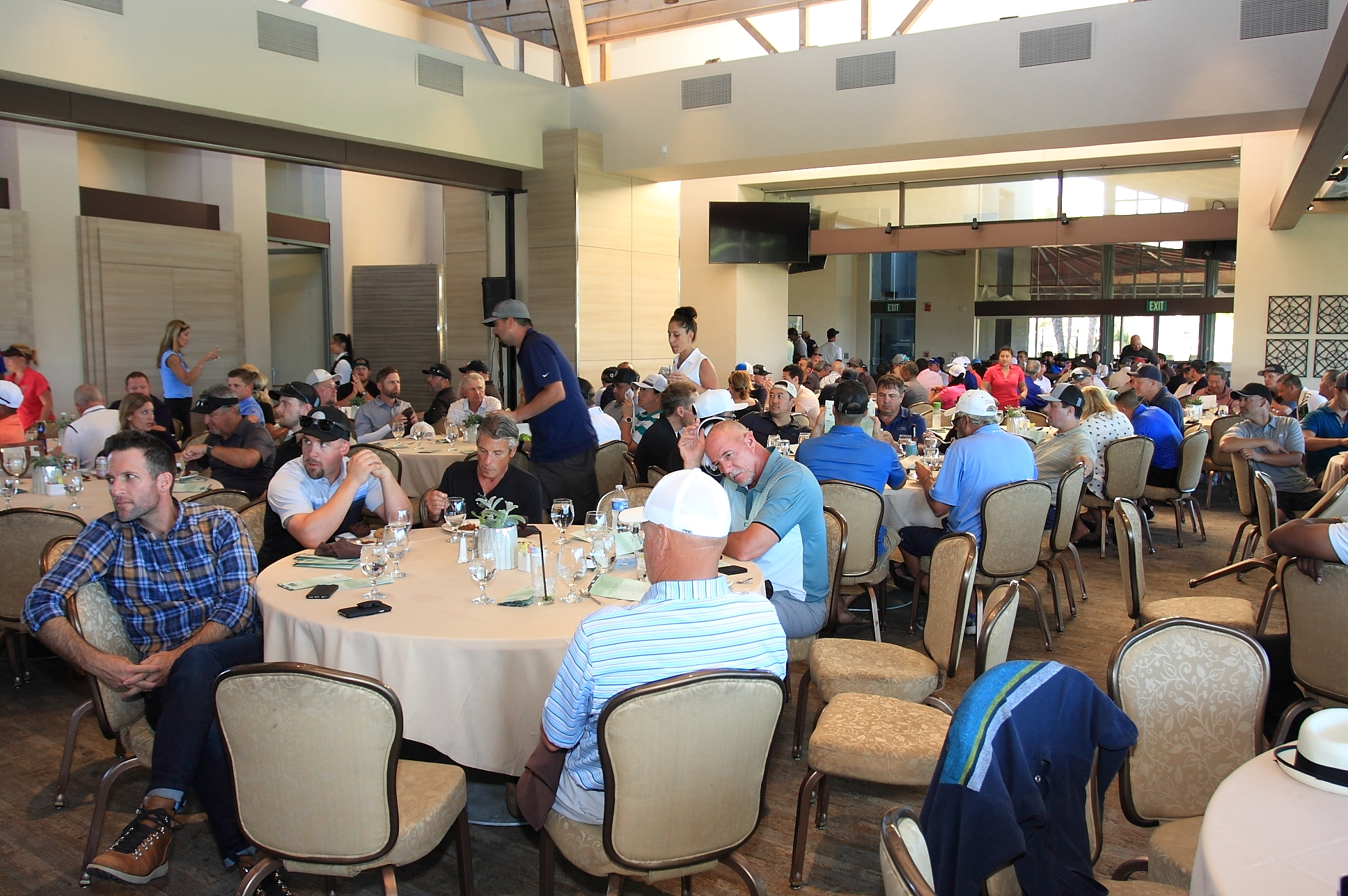 Golfers enjoying dinner after a long day out on the course.