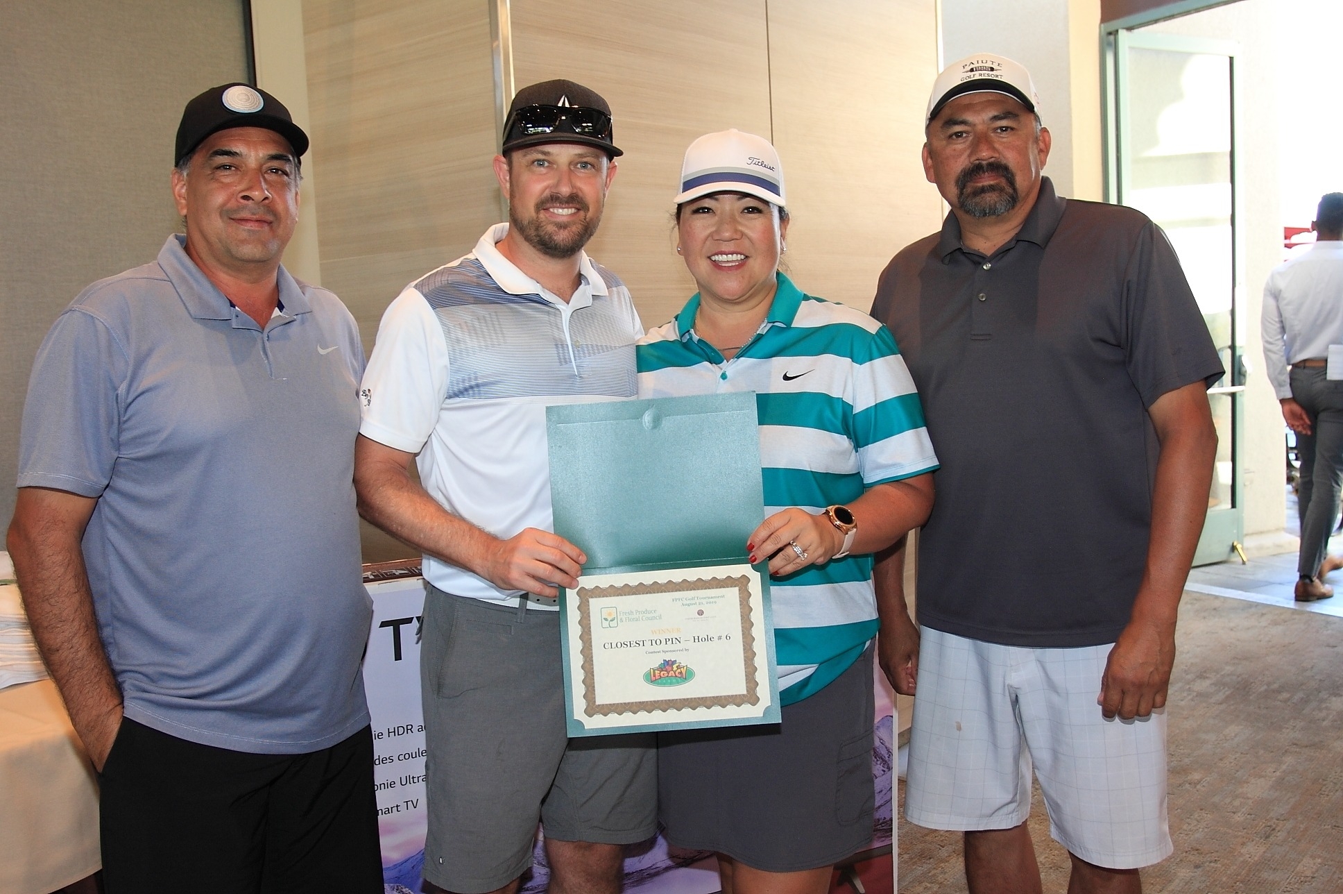 Closest to Pin Winner, Justin Whitcomb of Del Monte Fresh Produce with Cesar Valenzuela of Albertsons/Safeway/Vons, Mihae Finnie with Del Monte Fresh Produce, and Jeff Roa from Albertsons/Safeway/Vons.