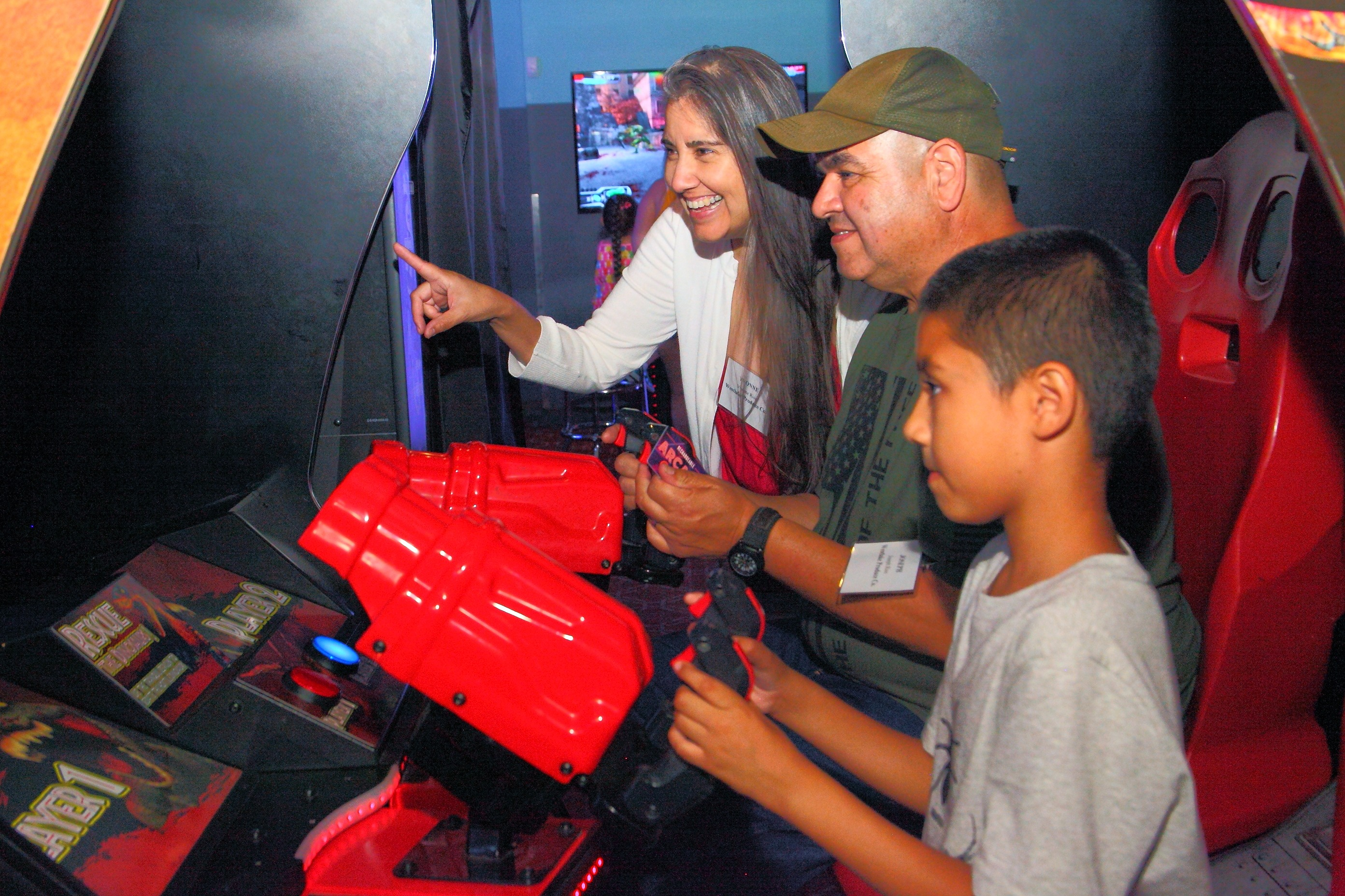 Yvonne and Joseph Rios from Westlake Produce Company, having fun in the arcade with their son!