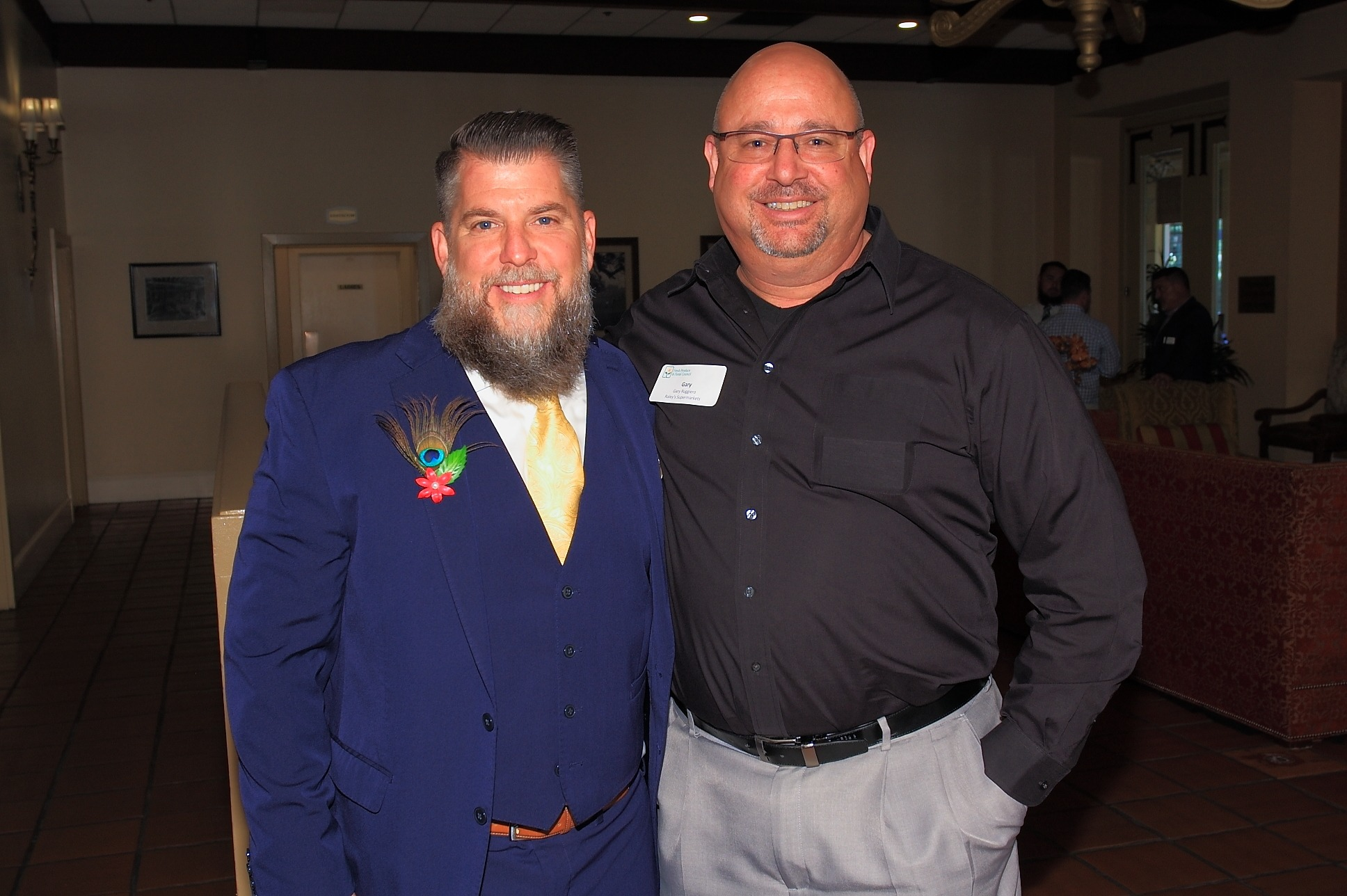 Michael Schutt and Gary Ruggiero of Raley's Supermarkets pose for a quick photo before the luncheon.