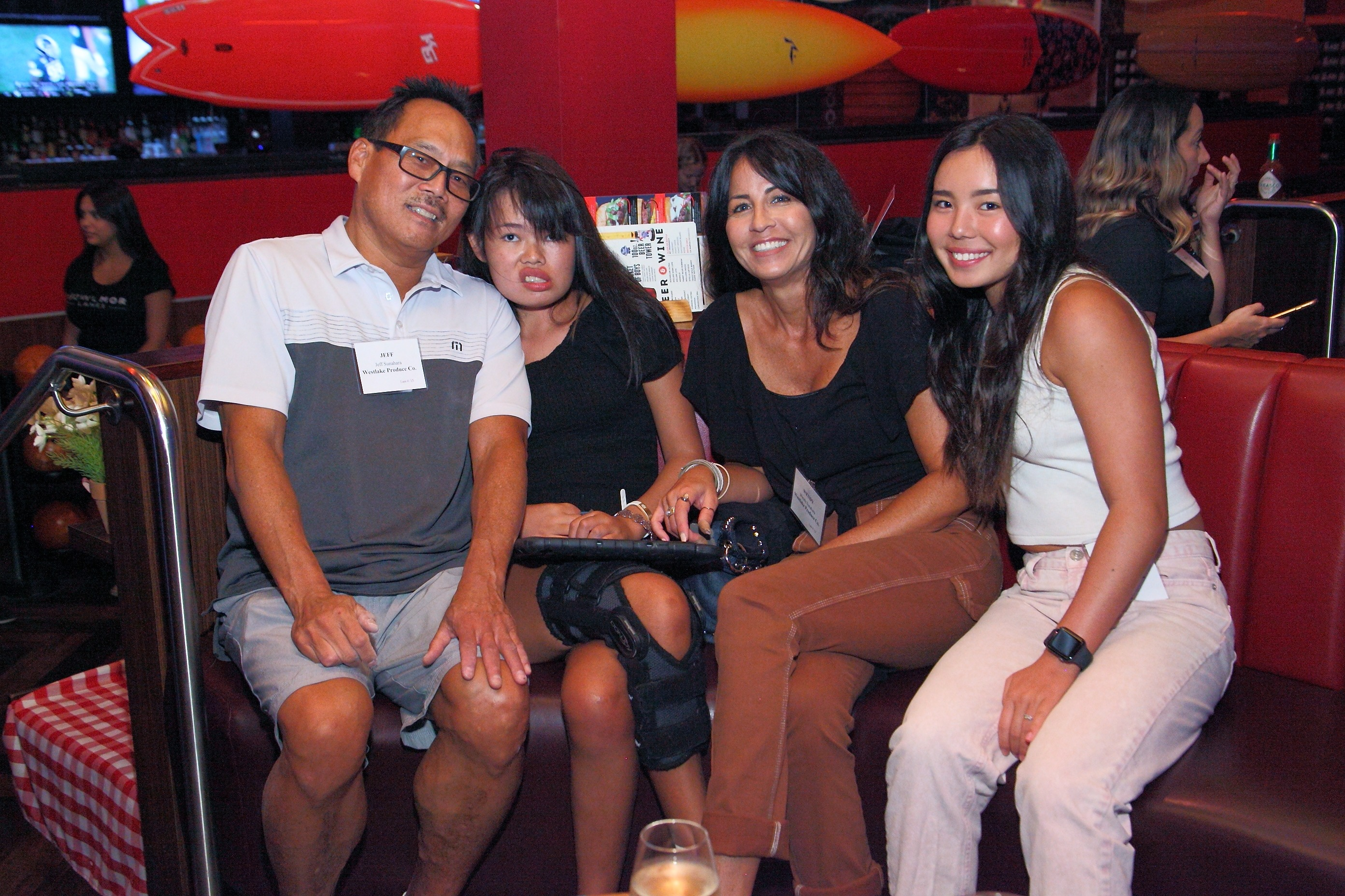 Jeff and Wendy Sunahara of Westlake Produce Company enjoying bowling with their two daughters.