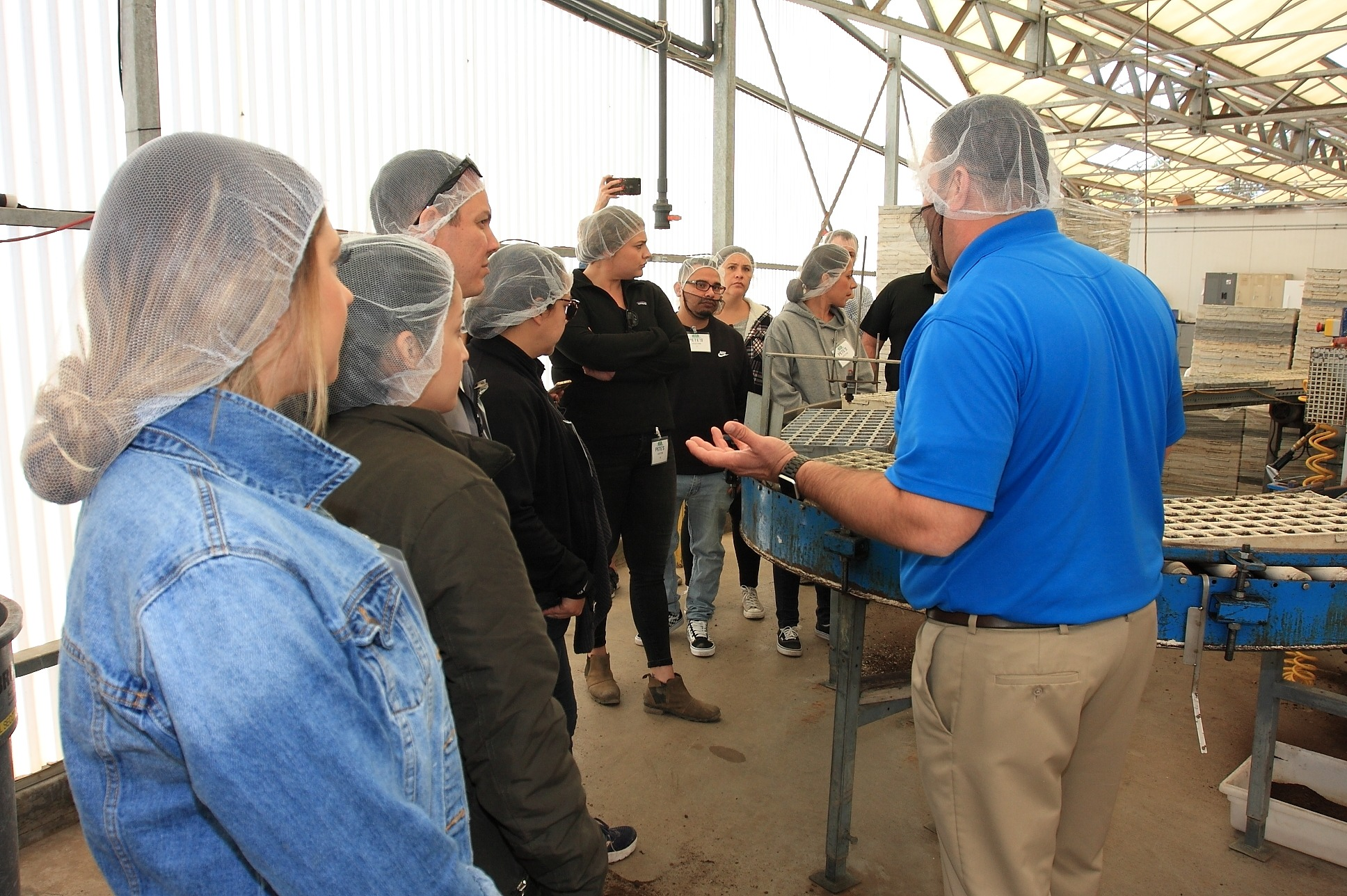 Apprentices Jessica Garica, Esmeralda Mejia, Jeffrey Fish, Briana Giampaoli, Jose Morales, Julie Boland, and Denise Gonzalez listen to Brian Cook, President of Pete's speak about the seed gemination process.